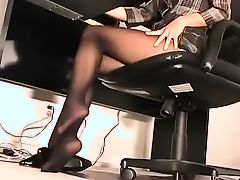 Gorgeous petite secretary working in black pantyhose