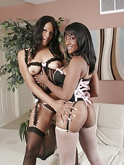 Two ebony sweeties fucking one another on the sofa