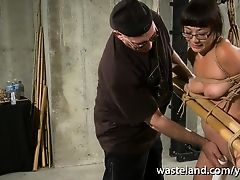 Bound and tied slave in glasses brought to intense orgasm by older Master