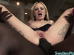 Blonde tattoo girl rides black cock