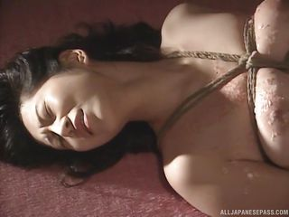 hot wax is poured all over this bound japanese slave