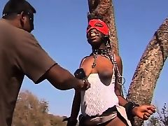 Slutty African babe gets abused in outdoor fetish action