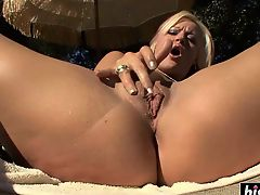 Beautiful girl fingers her shaved pussy