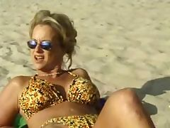 Beach babe takes strap-on in her pussy and a cock in her ass