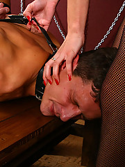 Two merciless bitches on stiletto heels beat, humiliate and trample a young submissive freak