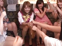 Two Japanese girls play lesbian games in the living room
