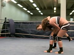 Horny Babes Fuck With A Strapon In The Middle Of The Ring