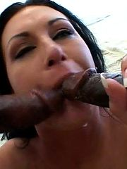 She graduates from a dildo to 2 black cocks