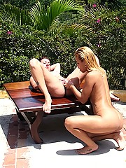 Petite lesbians fisting one another in the great outdoors