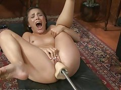 Dirty Brunette Gets Pumped by an Automatic Dildo