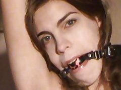 Tied and gagged brunette loves to tease