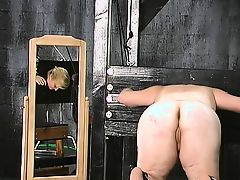 Blonde and brunette get torturously fucked in dungeon.