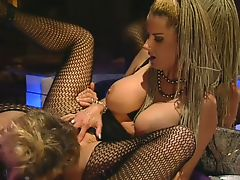 Lusty busty blondes in fishnets fuck on the bar