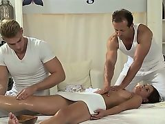 Two masseurs gangbang fucks and creampies babe on table