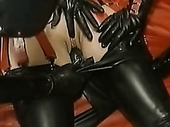 Latex Dildo pants being worked in bondage girl