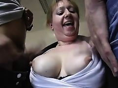 Horny granny enjoys two cocks